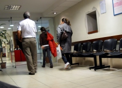 Patients walking through a clinic waiting room