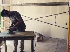 Joe Sammen works on his under-construction house