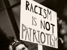 Anti-racism sign at a protest