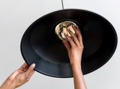 Hands change a light bulb