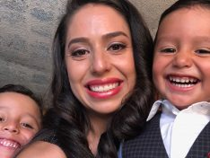 Erika Serrano, a latina and staff member of Center for Health Progress, poses for a selfie with her two young sons, all dressed up to go to a quincinera